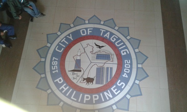 may isda, ibon, kalabaw, at lighthouse sa seal ng taguig